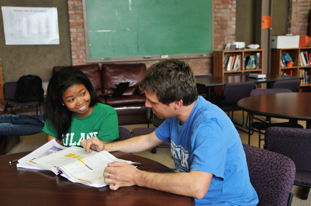 A math tutor explains some basic concepts to a student.