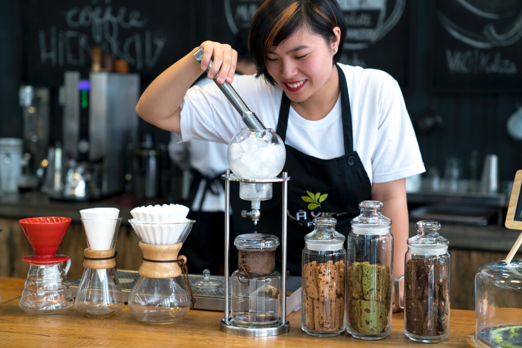 A student working as a barista.
