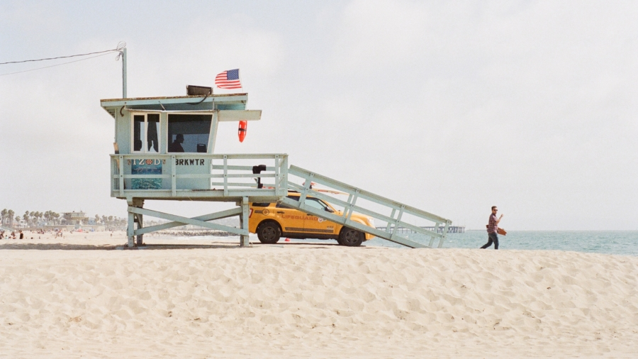 A lifeguard looking at the ocean.