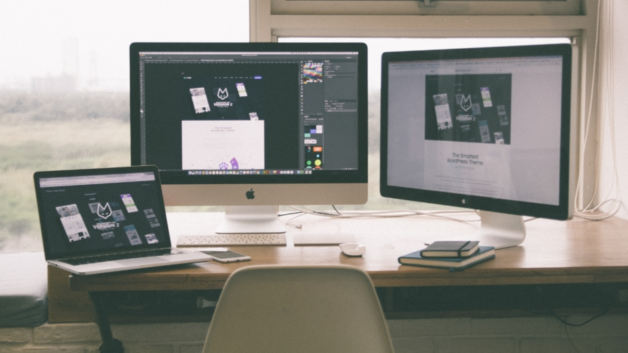 The desk of a student working as a freelance graphic designer.